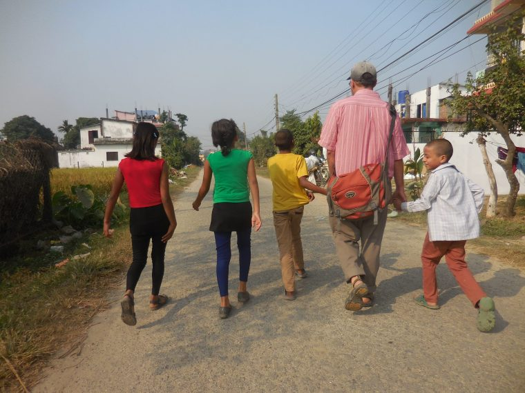 Samurai and some of the kids he works with in Nepal. Photo courtesy of Monika Fleming.