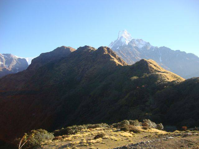 High Camp in the Annapurna Region of Nepal. Machupuchara sits in the distance. Monika trekked with a Nepali guide all the way from the village of Nayapul then made her way to High Camp and then to Machupuchara. Photo courtesy of Monika Fleming.