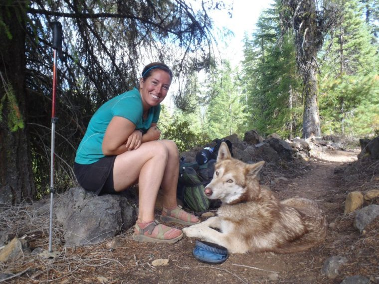 Molly and Scout, Molly wears Chacos to help alleviate blisters while hiking the Pacific Crest Trail.. Photo courtesy of Molly Liston.